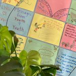 """Heart drwan across multiple colored paper sheets. Text and illustrations are showcased in each sheet. Main text reads, """"LYRIC loves you! Messages from Youth 4 Youth."""" Messages include, """"Abuse is never ok,"""" """"never stop being there for a friend even when they can't let go of a bad situation."""""""