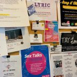 Flyers posted on a corkboard feature in-house programs, community events and health navigation information.
